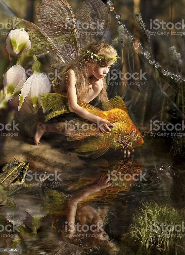 Girl elf And goldfish stock photo