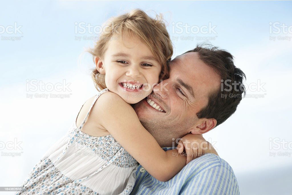 Girl embracing father stock photo