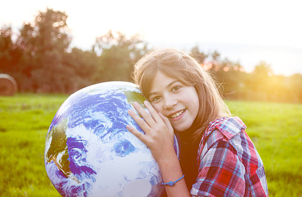 girl embracing globe - recycling heart bildbanksfoton och bilder