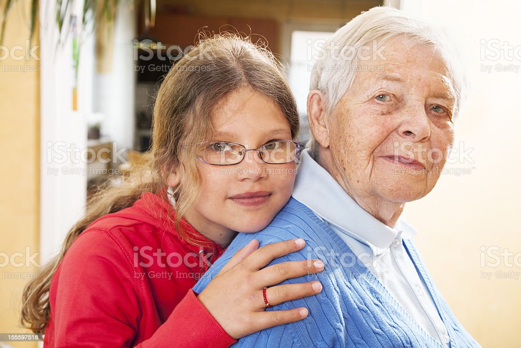 girl embracing great grandmother royalty-free stock photo