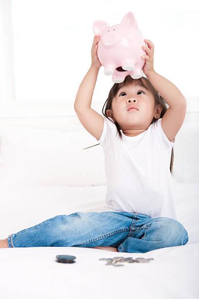 Girl empty piggy bank stock photo