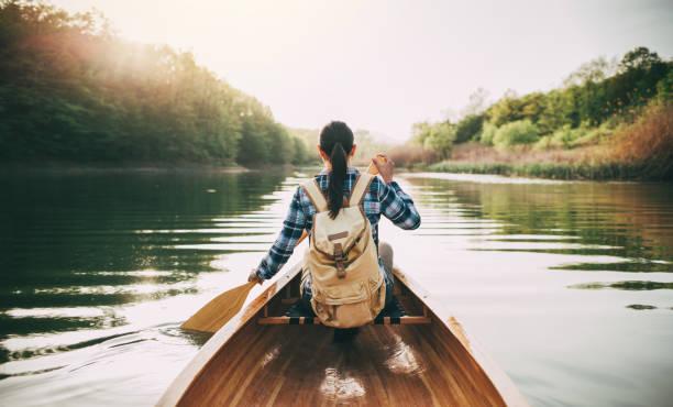 Girl enjoy canoeing stock photo