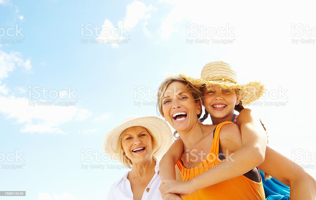 Girl enjoying a back ride on mother stock photo