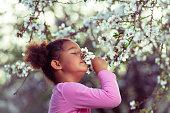 istock Girl Enjoying blooming aroma. 1132281139