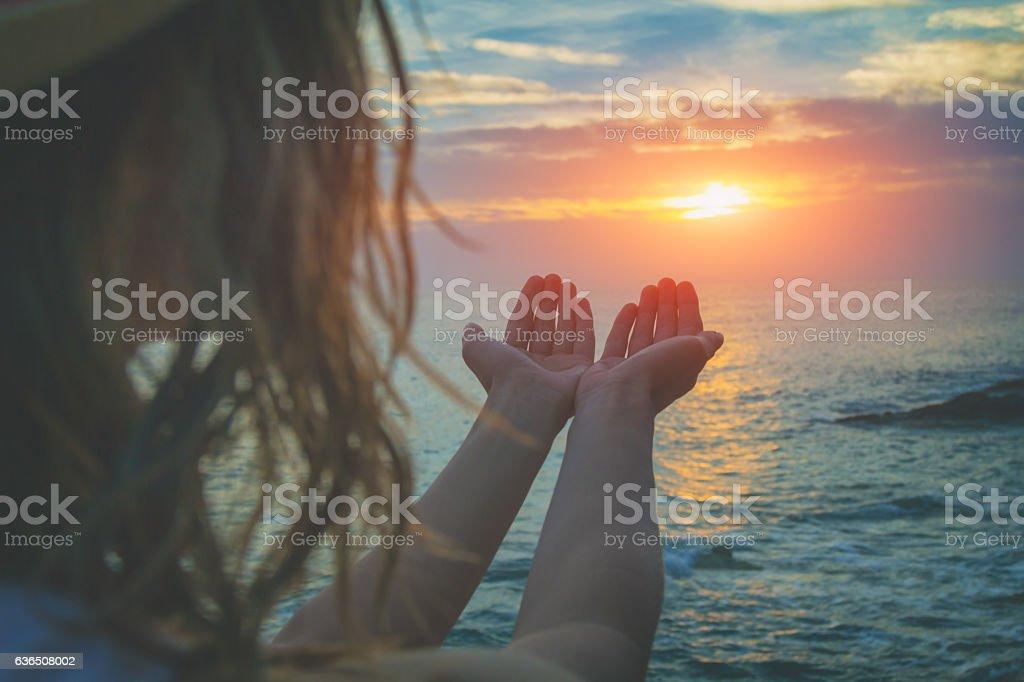 Girl enjoying free with ocean / sea background. stock photo