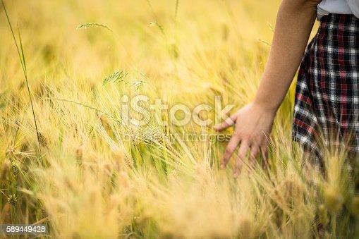 523172398istockphoto Girl enjoying in a countryside scenic 589449428