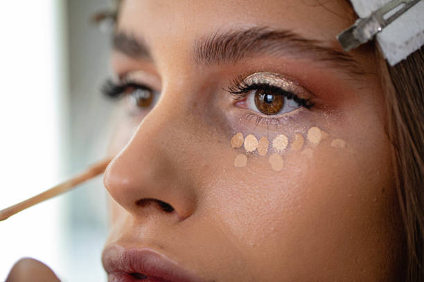 Girl enjoying make-up stock photo