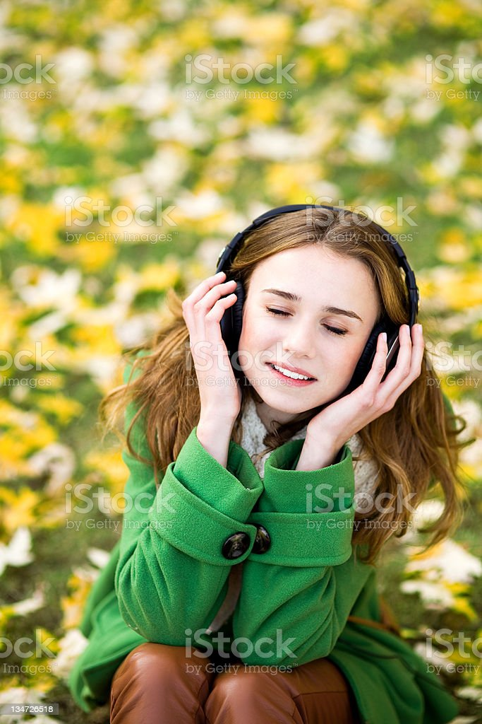 Girl enjoying music outdoors royalty-free stock photo