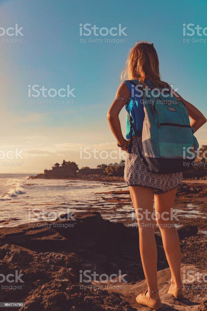 Girl enjoying sea / ocean scenery in Bali, Indonesia. royalty-free stock photo