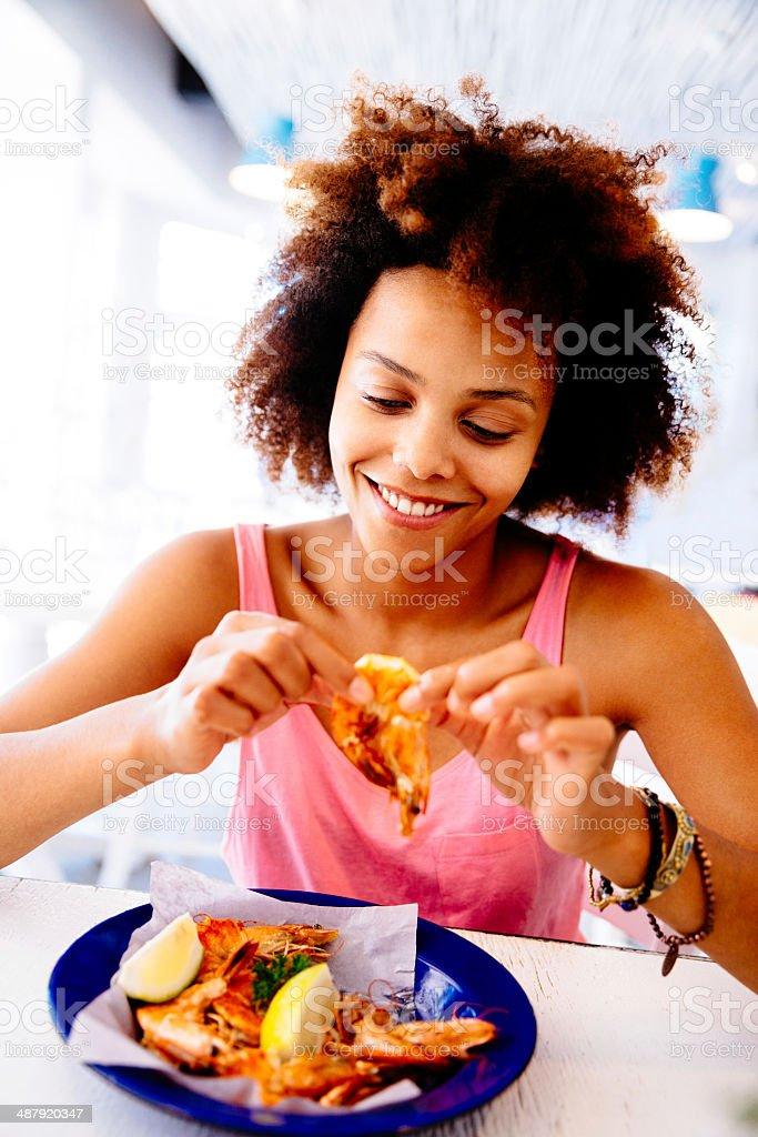 Girl Enjoying seafood in Restaurant stock photo