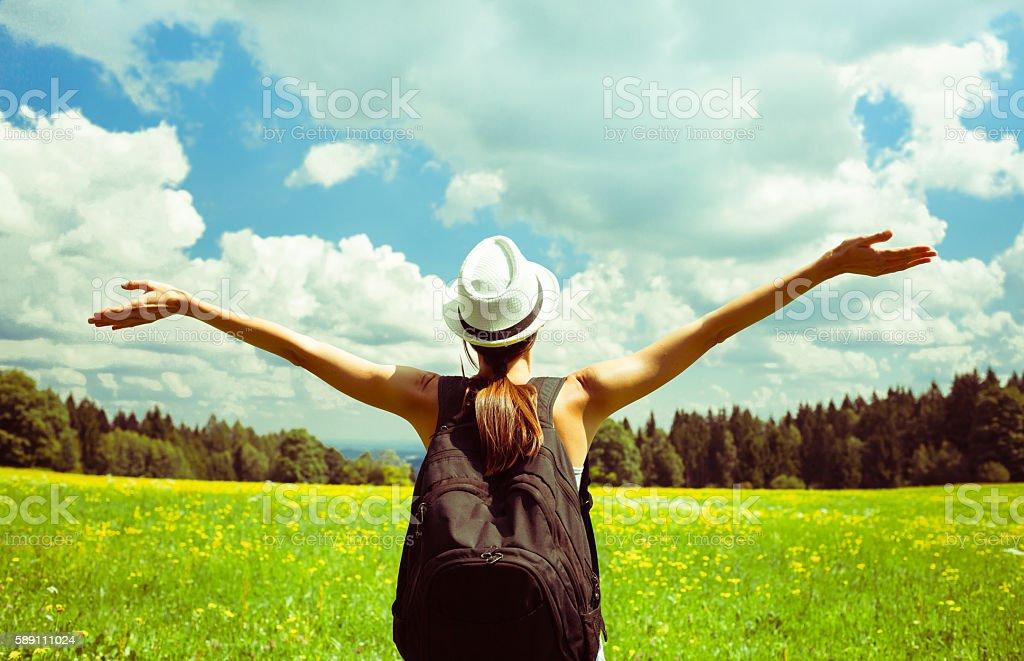Girl enjoying the freedom outdoors. stock photo