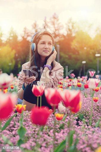 623358818 istock photo Girl enjoying the music in the park 473558708