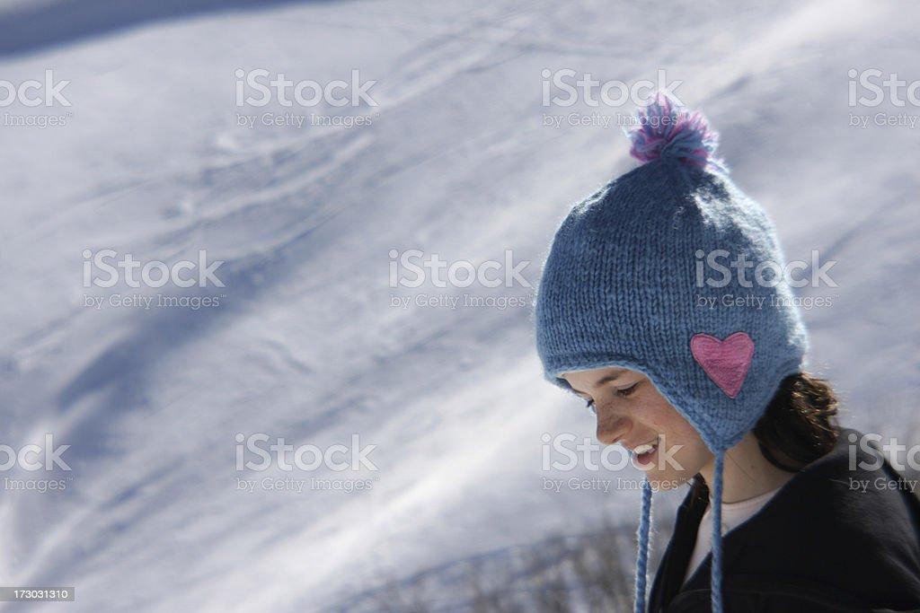 Girl enjoying the sun and snow royalty-free stock photo