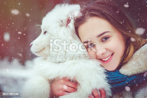istock Girl enjoying winter with her dog 904195236