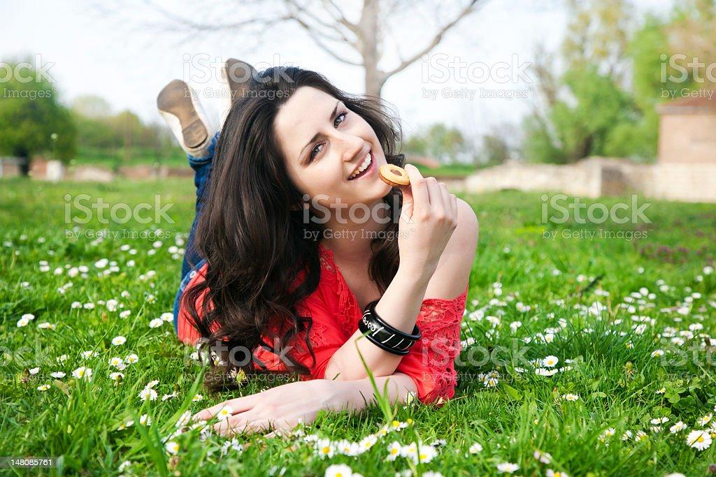 Girl enjoys a cookie stock photo