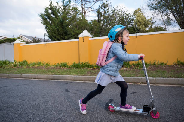 Girl enjoys a sustainable commute to school stock photo