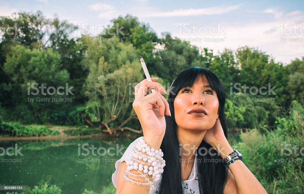 girl enjoys in free time and smoking a cigar stock photo