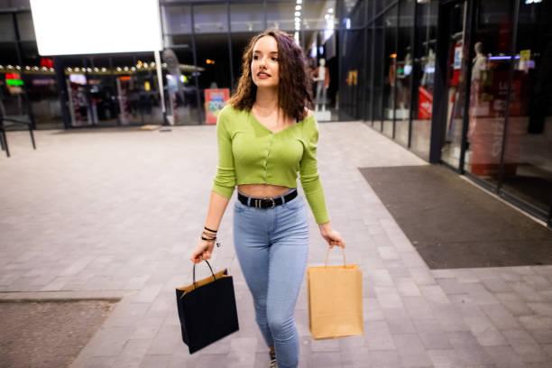 Girl enjoys in shopping