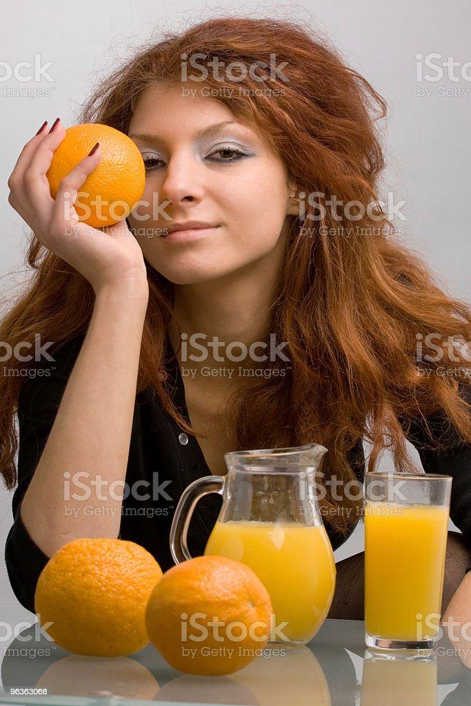 Girl enjoys oranges royalty-free stock photo