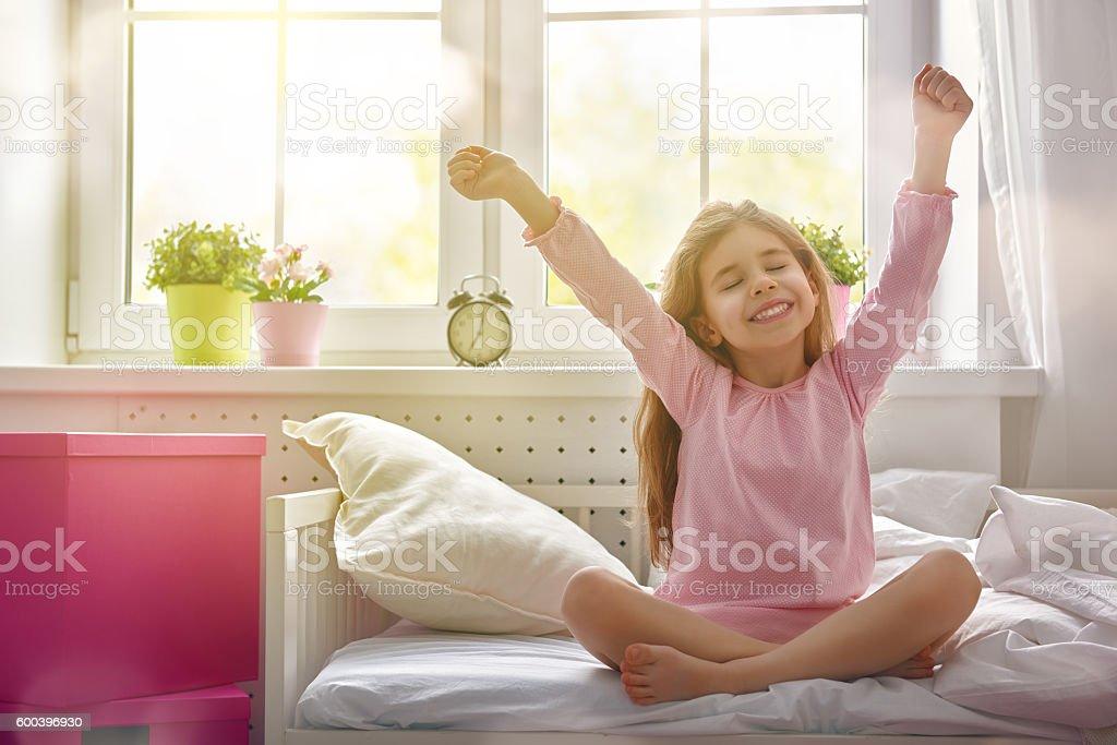 girl enjoys sunny morning stock photo