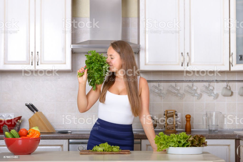 Girl enjoys the smell of fres parsley stock photo