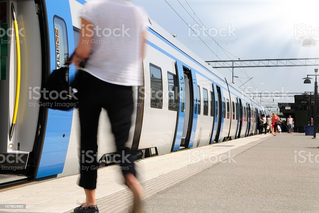 Girl entering train in strong sunlight royalty-free stock photo