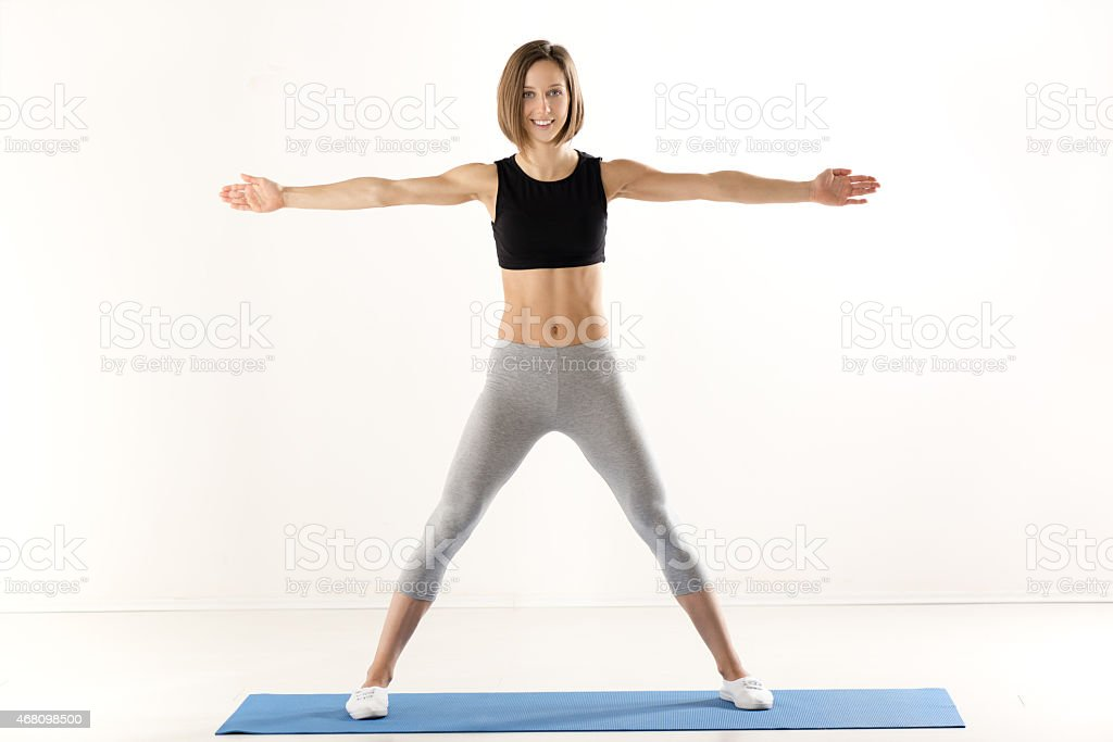 Girl Exercise With Outstretched Arms stock photo