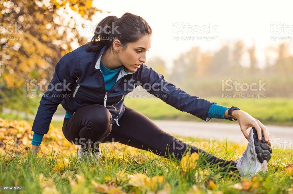 Girl exercising at park stock photo