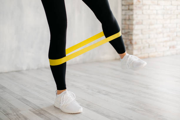 girl exercising fitness elastic resistant band, close up stock photo