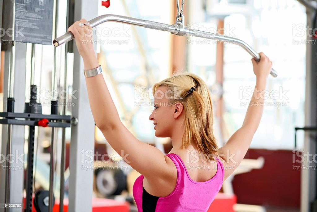 Girl exercising in a fitness center. stock photo