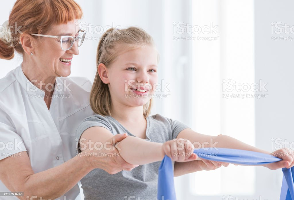 Girl exercising with resistance band stock photo