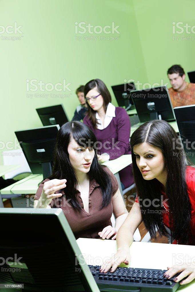 Girl explains the computer stock photo