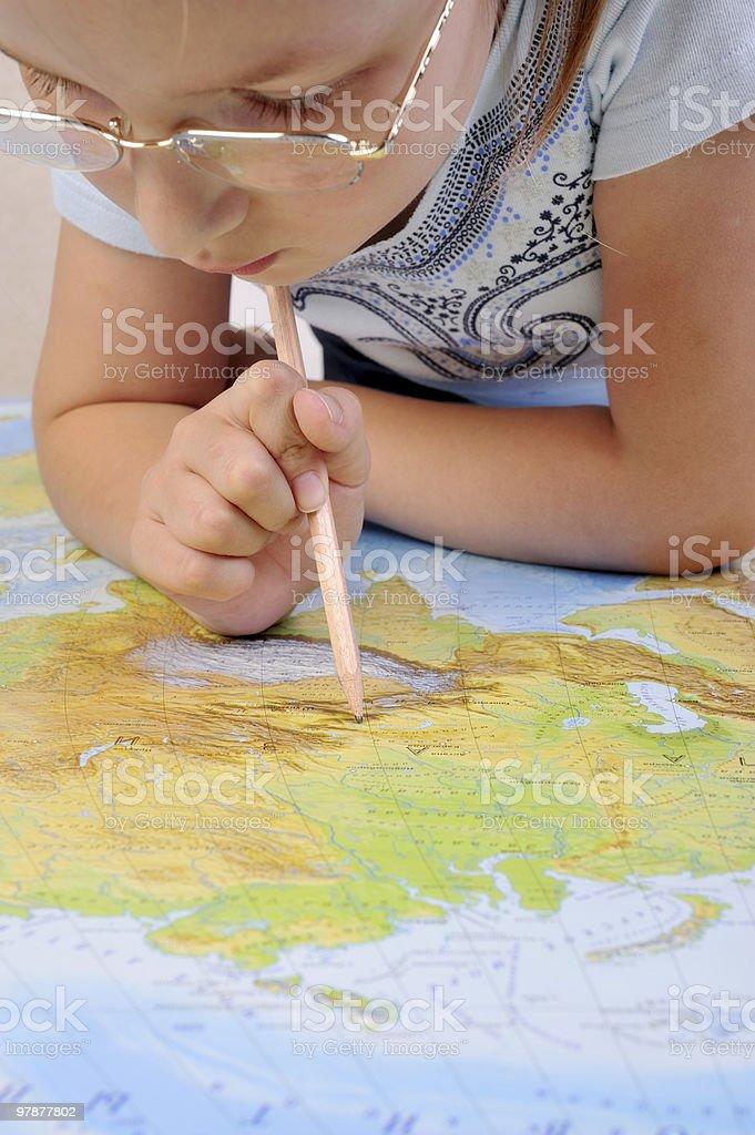 Girl exploring the map of Eurasia royalty-free stock photo