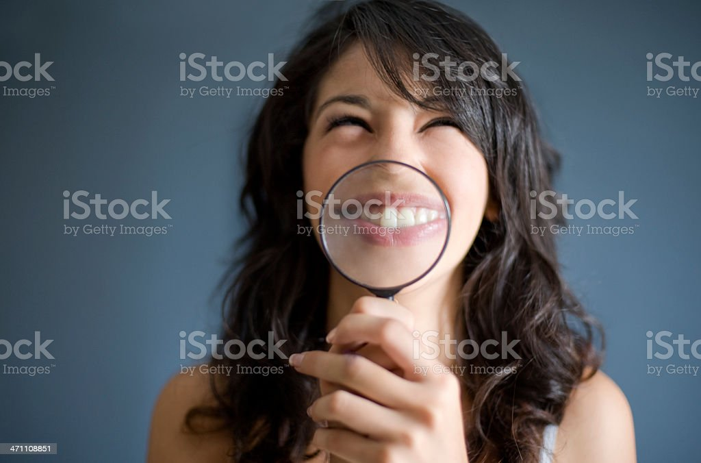 girl face being magnified royalty-free stock photo