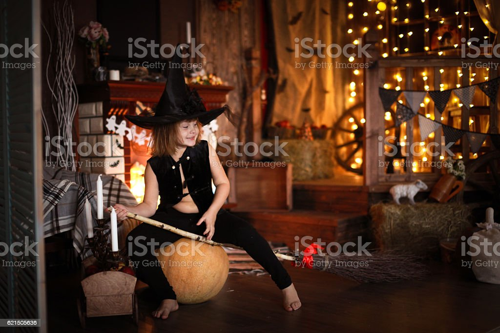 Girl fairy, witch on  broom with pumpkin. Halloween foto stock royalty-free
