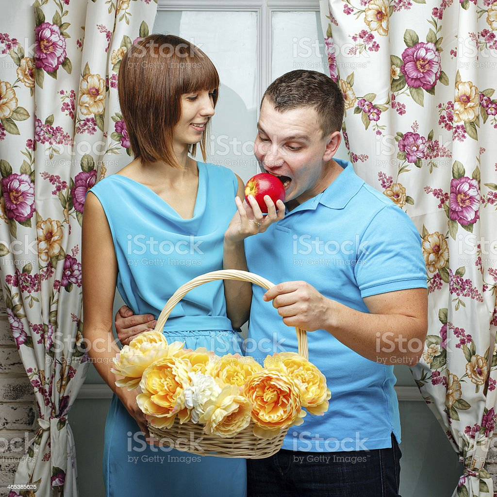 Girl feeding her boyfriend stock photo