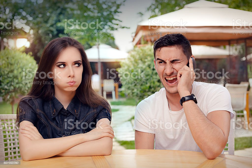 Girl Feeling Bored while her Boyfriend is on The Phone stock photo
