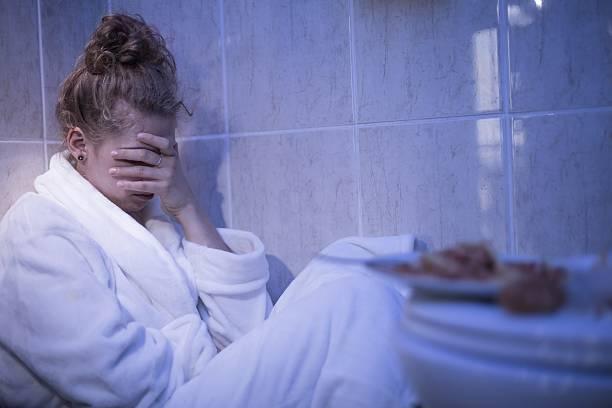 Garota se sentir doente - foto de acervo