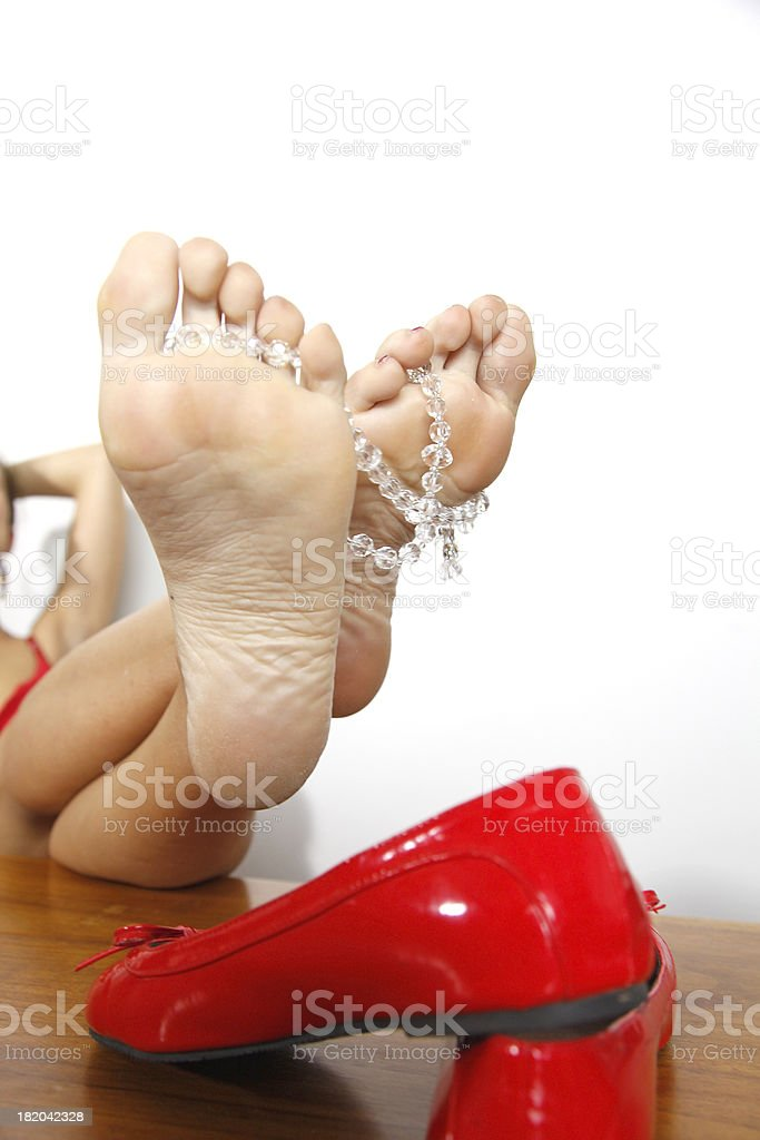 Girl feet on table with jewelry stock photo