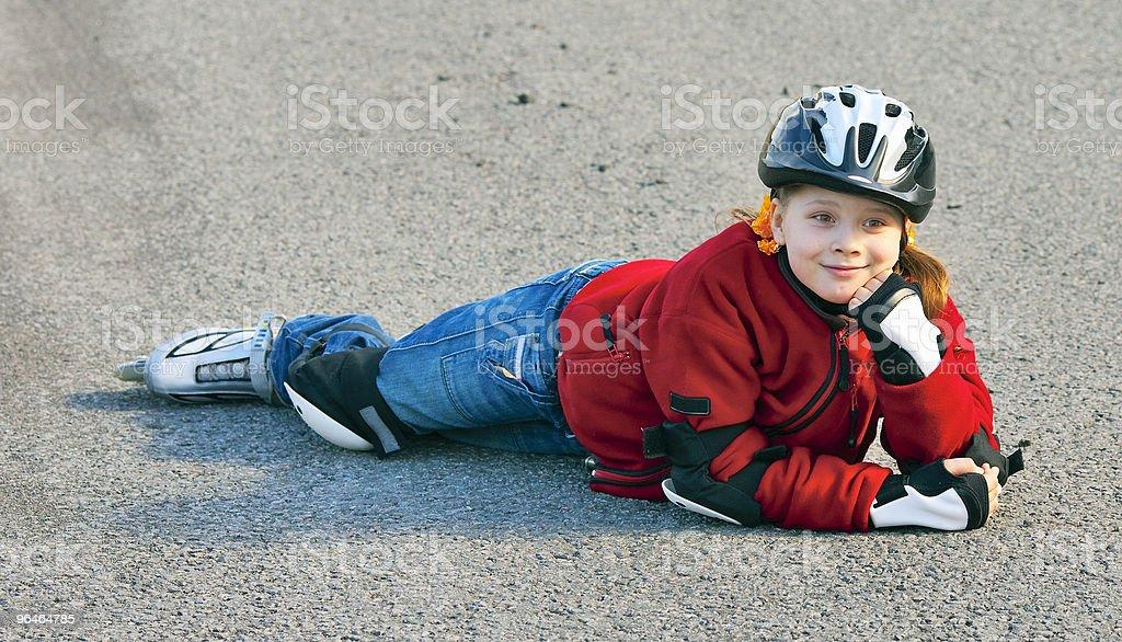 Girl fell on the asphalt royalty-free stock photo