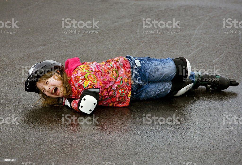 Girl fell on the wet asphalt royalty-free stock photo
