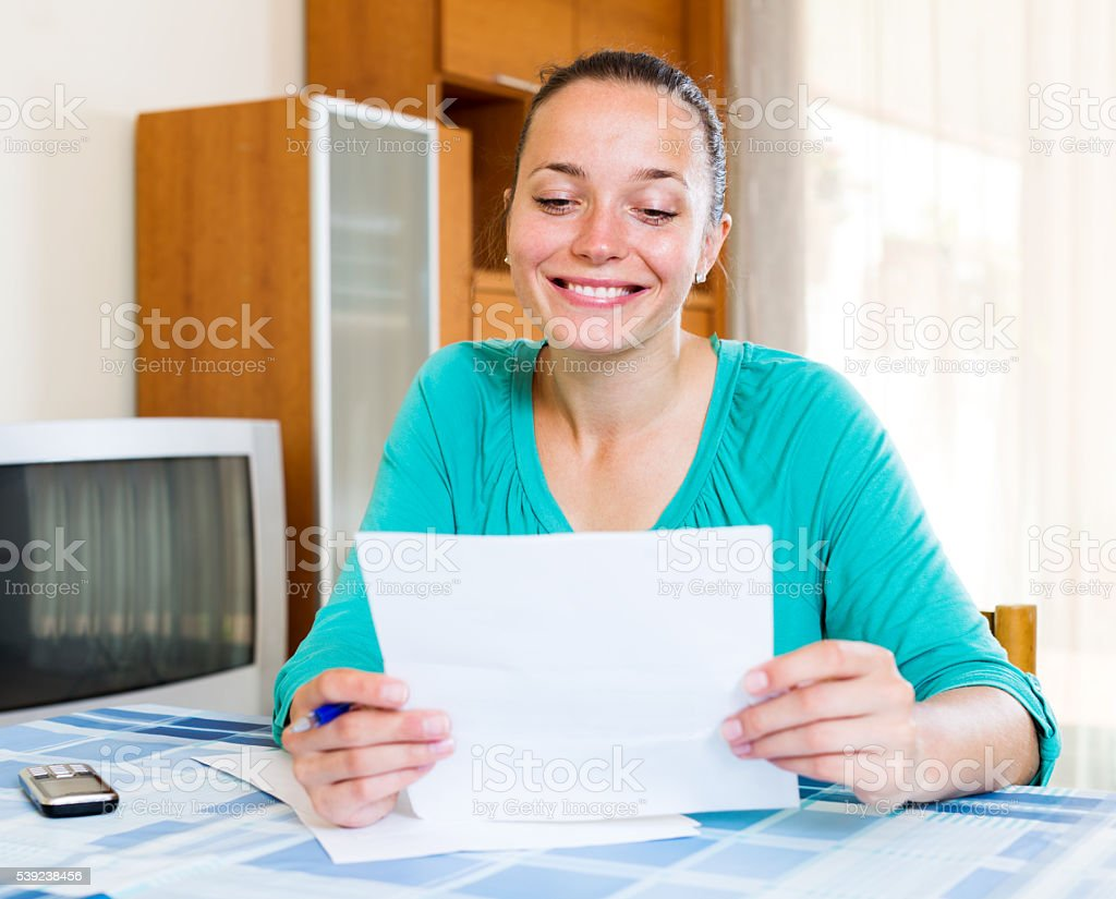 girl filling out tax forms royalty-free stock photo