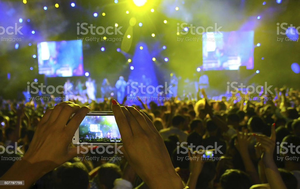Girl filming with smartphone stock photo