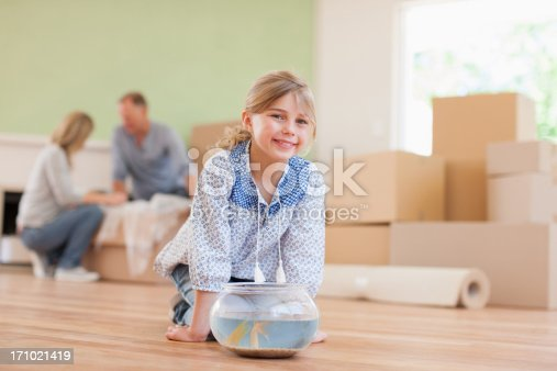 109350576 istock photo Girl fish bowl in her new house 171021419