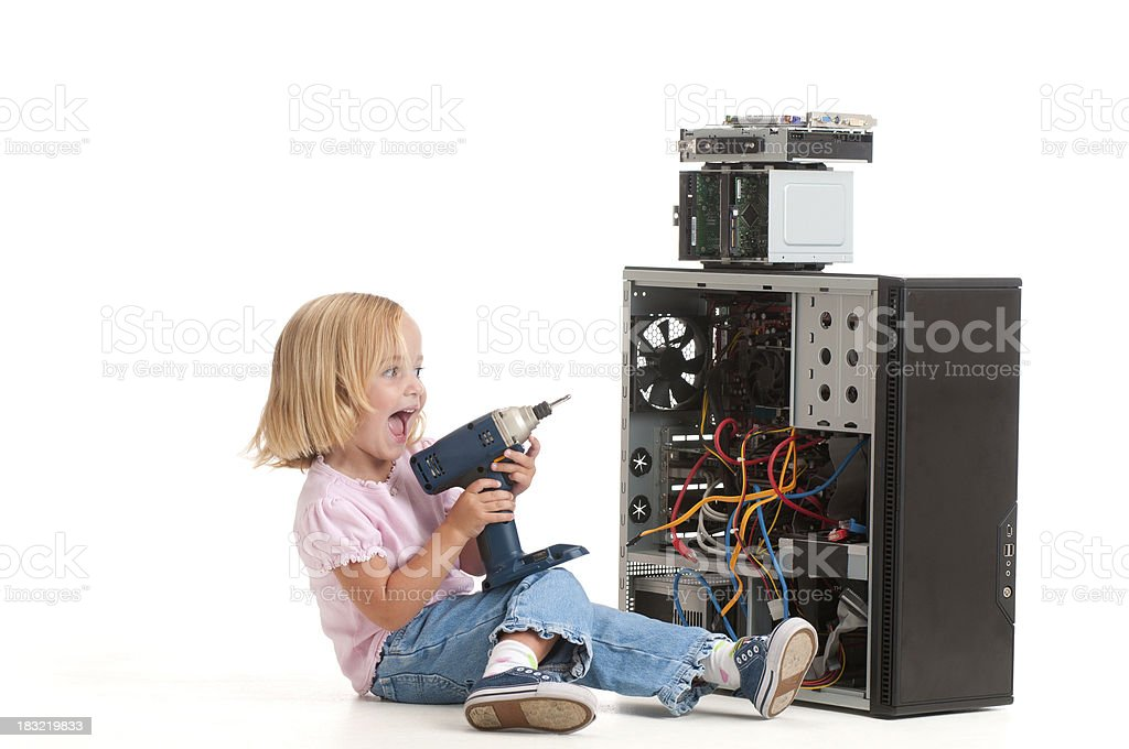 Girl 'fixing' her computer with a power drill. royalty-free stock photo