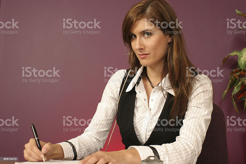 girl Friday writing down the information royalty-free stock photo
