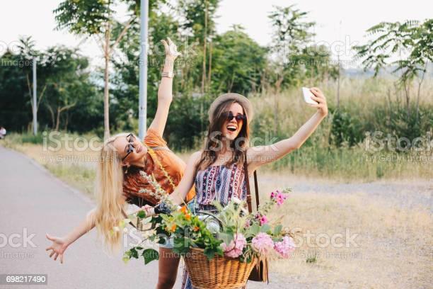 Girl friends are taking selfie on a bike picture id698217490?b=1&k=6&m=698217490&s=612x612&h=lc3yqiqodwxsxqhtmbhpvsrxshwesgwglfmwmlvj0qi=