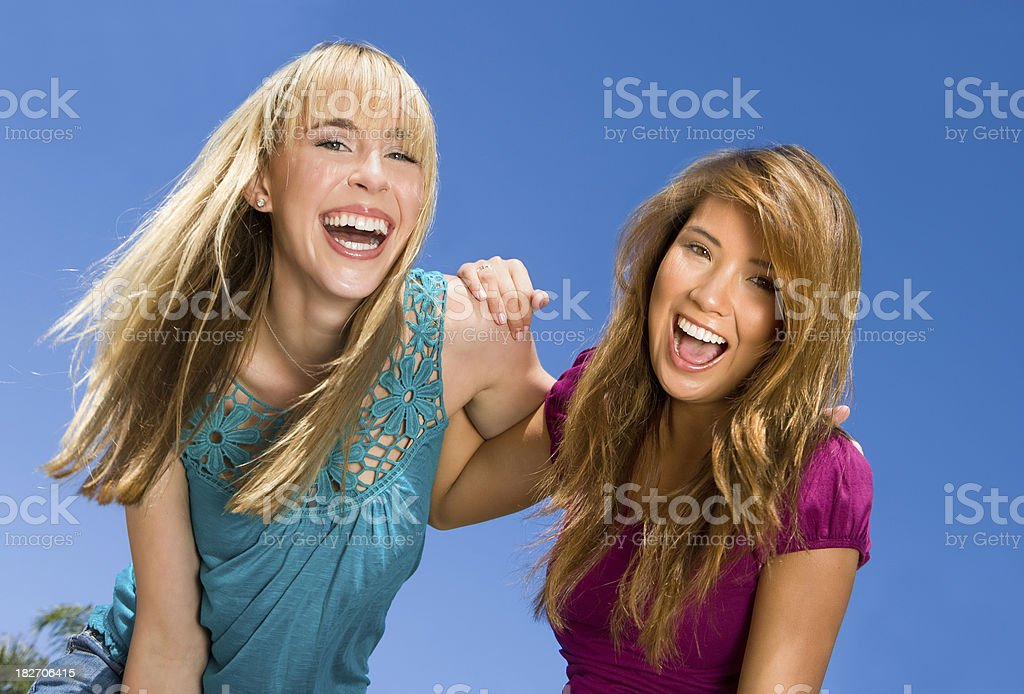 girl friends laughing together royalty-free stock photo