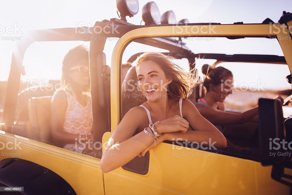 Girl friends on a summer vacation road trip stock photo
