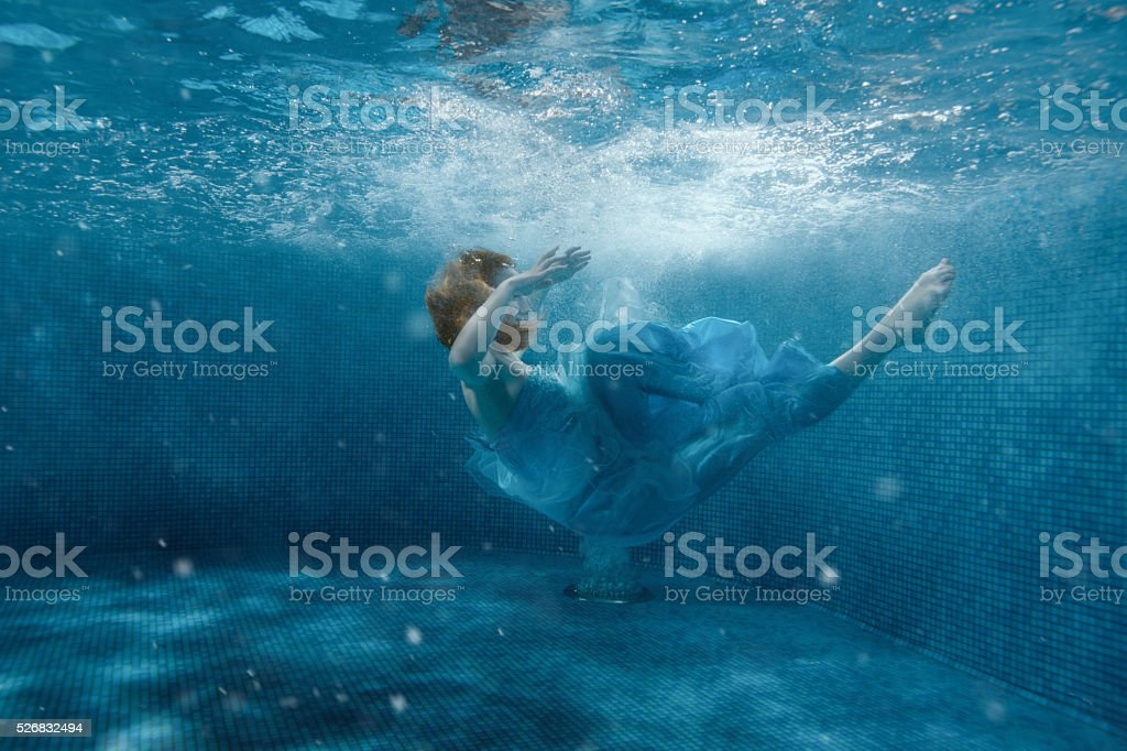 Girl from the fairy tale, she sinks. stock photo